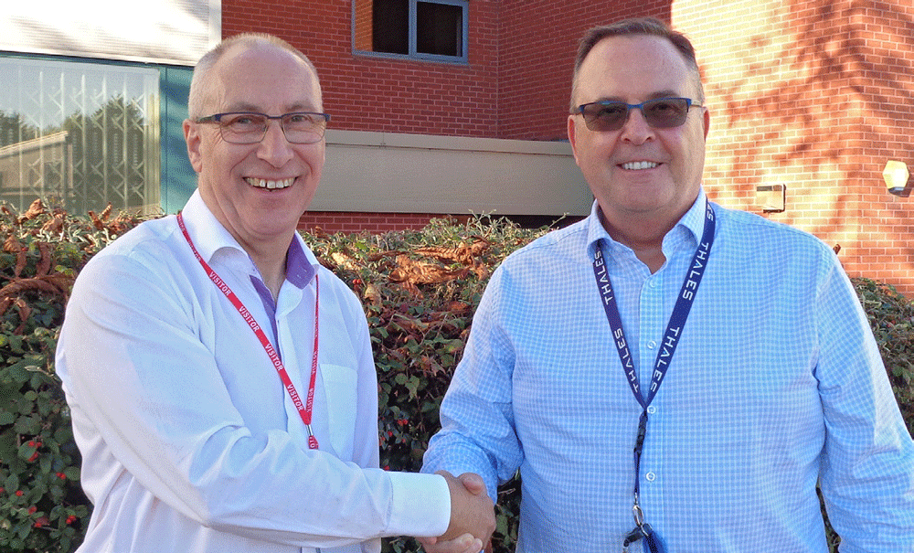 Chief Executive Officer of Scientific Management International, Keith Wells with Phil Jones, Managing Director of Maritime Mission Systems Thales UK in October 2018