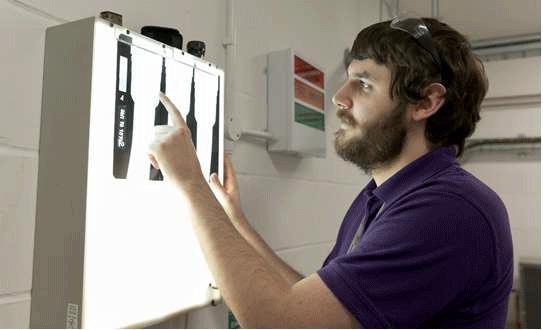 SMI team member teaching Apprentices