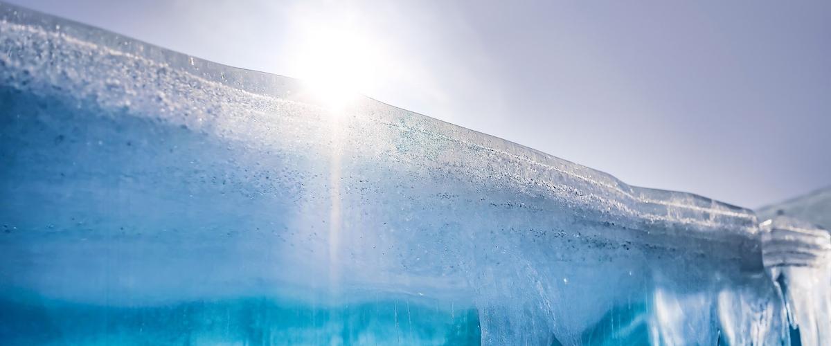 Iceberg cliff face with sunshine