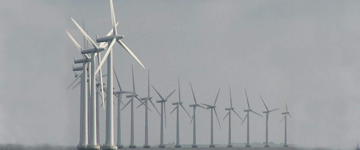 Semi circle of wind turbines at sea