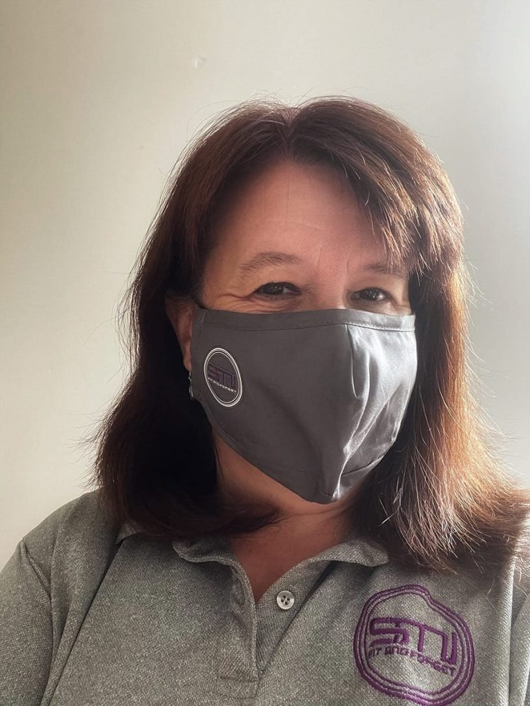Jenny Shaw, from SMI, wearing a face mask at DSEI